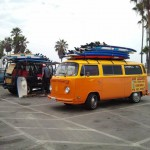 VW Bus piled high with surfboards